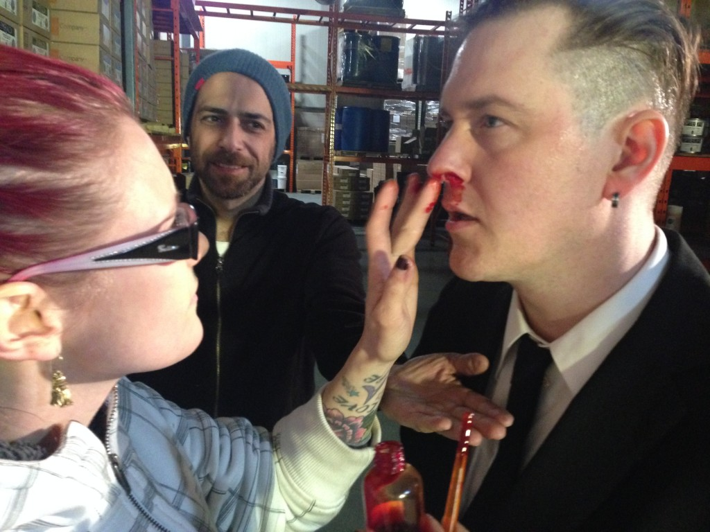 Anthony, our producer, catches blood while make-up artist does one over on Adrian's face