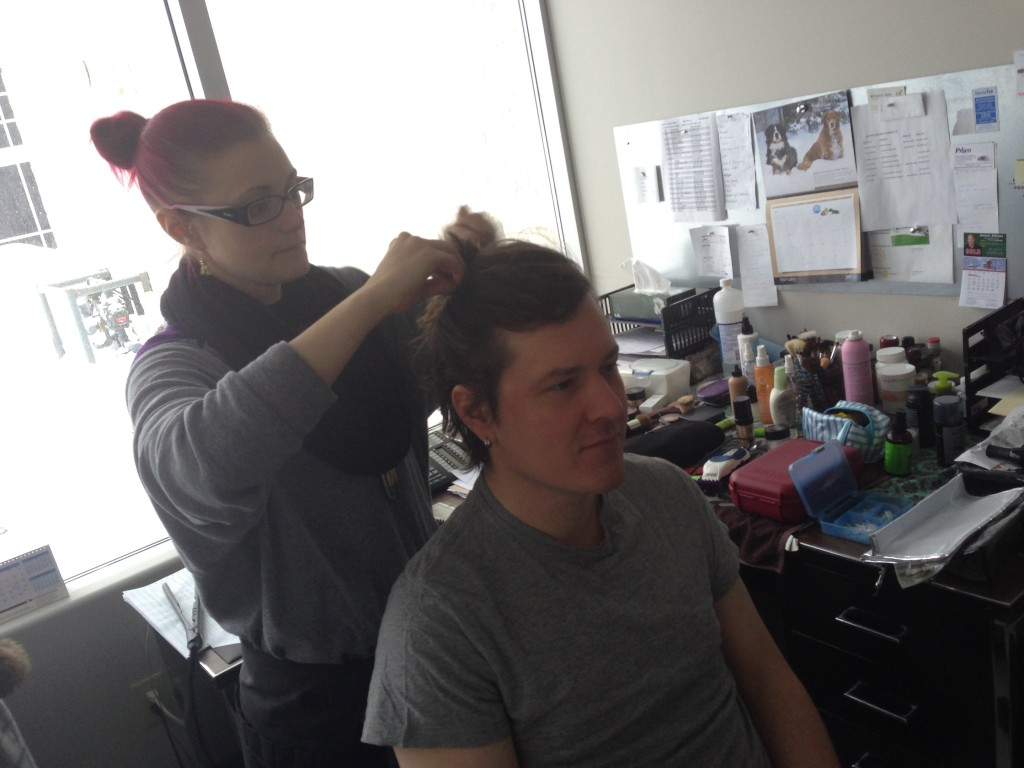 Make-up artist Trina gets Adrian ready for a haphead head shave
