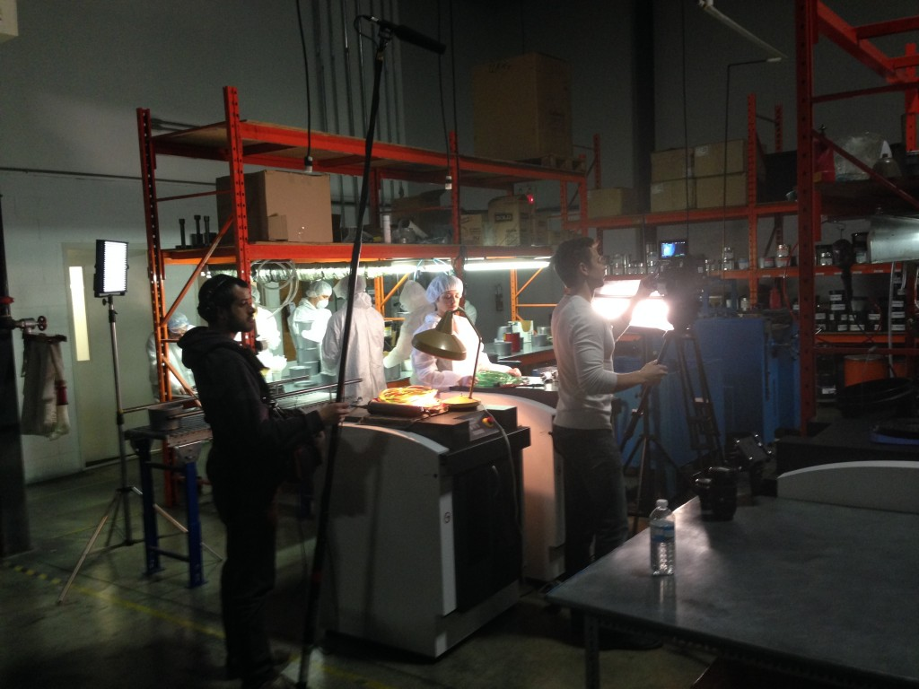 Tony lighting set while Ryan and factory workers get ready