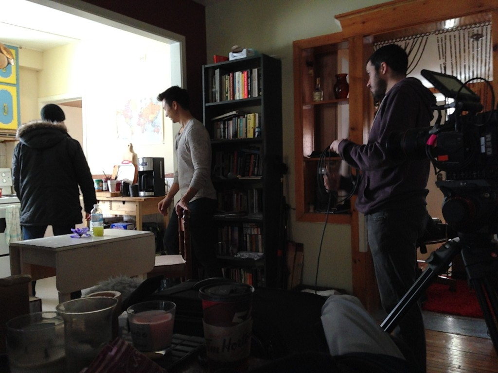 Sound recordist Ryan, DP Tony, and director Tate preparing for kitchen shoot