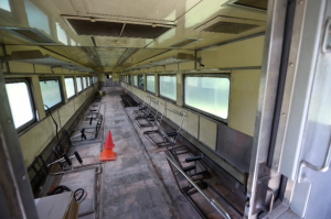 Inside of an abandoned, dilapidated commuter train