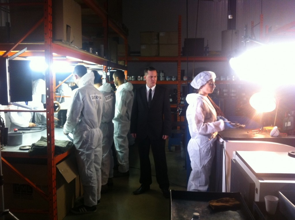 Adrian watches factory workers