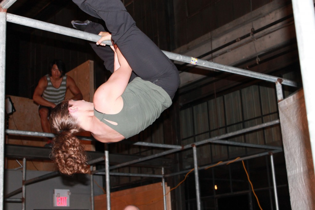 Woman hang on bars