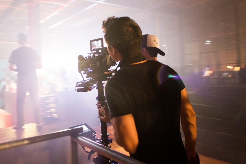 Tony looks through camera viewfinder