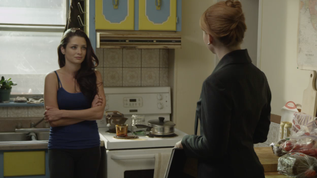 Maxine stares down the Insurance agent Katherine